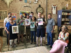 Diverse Group with Paintings