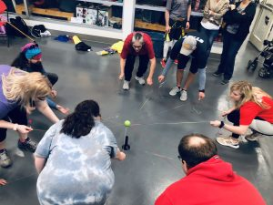 Group of People in Circle Playing a Game